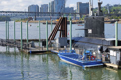 Moored submarine & a jet-boat. Royalty Free Stock Photo