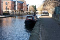 Moored Up on the canal. A canal barge moored up on the Leeds Liverpool canal in Wigan Stock Image