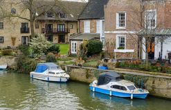 Moored-up, private boat seen by a private residence in England. royalty free stock photography