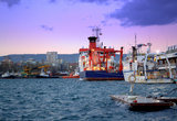 Anchored vessels at evening port. Moored ship in the port.Photo taken on sunset at Varna port, Bulgaria, Europe on December,2013.RV Maria S. Merian is Germanys Royalty Free Stock Image