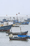 Moored vessels in a snow shower, Weihai, China. WEIHAI-CHINA-DEC. 2. Moored vessels in a snow shower. Weihai, Shandong Province, has a semi-tropical monsoon Royalty Free Stock Image