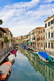 Moored work boats. Along quiet canal in Venice Italy Royalty Free Stock Photo