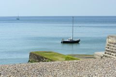Moored yacht off Brighton Marina. England Royalty Free Stock Photography