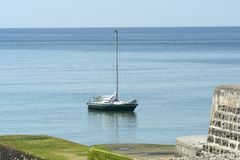 Moored yacht off Brighton Marina. England Royalty Free Stock Image