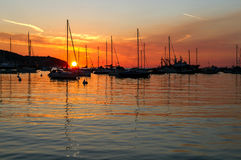 Moored yachts in the Adriatic Sea harbor in Slovenia in the sunset. Royalty Free Stock Images