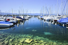 Moored yachts at harbor in Lake Geneva, Switzerland. GENEVA–JULY 25. Moored yachts in Lake Geneva: A recent Mercer survey found Geneva to have the third royalty free stock image