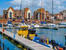 The moored yachts and luxury houses in harbor Stock Photo