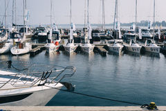 Moored yachts and sailboats at famous Sopot pier. SOPOT, POLAND - SEPTEMBER 12 2016: Moored yachts and sailboats at famous Sopot pier with Gdansk Bay on the royalty free stock images