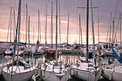 Moored yachts at sunset. In Slovenia Stock Images