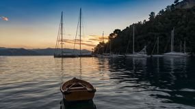Moored yachts and wooden dinghy, Portofino Alba royalty free stock photos
