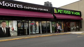 Moores and pet food more storefront stock footage