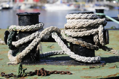 Mooring. Rope of the boat in the dock Stock Photos