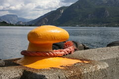 Mooring. At a harbor, with a fjord in the background stock image