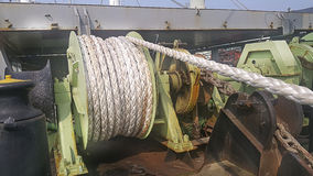 Mooring anchor winch. In ship yard at rope anchor stem dock Mooring anchor winch when ship repair Stock Images