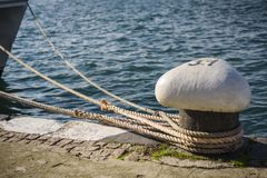 Mooring bitt with ropes royalty free stock images