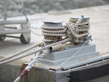 Mooring bitt wrapped rope Stock Photos