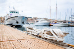 Mooring and boats in harbor Royalty Free Stock Image