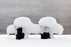 Mooring bollard. Covered with snow on a cold winter day Royalty Free Stock Photo