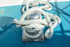Mooring bollard with a fixed rope Stock Photography