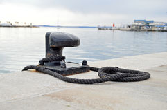 Mooring Bollard-Yacht Sailing Dockside Rope. A mooring bollard in a harbour royalty free stock photography