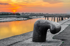 Mooring bollard, iron cleat with colorful sunset Stock Images