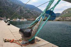 Mooring bollard with knotted nautical ropes Stock Photo