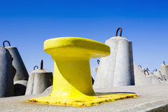 Mooring bollard painted in yellow Stock Photography