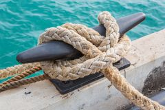 Mooring Bollard with rope Royalty Free Stock Photo