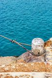 Mooring bollard with a rope, Blue Lagoon, Comino Island harbor, Malta stock images