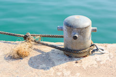 Mooring Bollard with rope Stock Photos