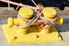 Mooring bollard with rope on pier by the sea Stock Images