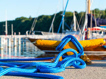 Mooring bollard with rope on pier by the sea Royalty Free Stock Photo