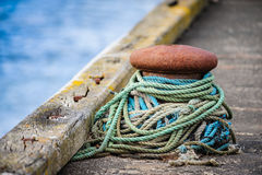 Mooring bollard with ropes stock photos