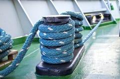 Mooring bollard. Mooring ropes and mooring bollard on a cargo vessel royalty free stock images