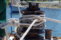 Mooring bollard with ropes on pier Royalty Free Stock Photo