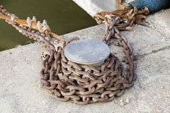 Mooring bollard with rusty chain on the river berth stock photos