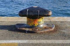 Mooring bollard by the sea Stock Photo