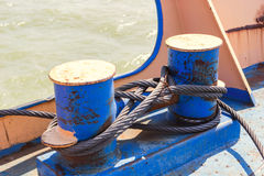 Mooring bollard with wire ropes. On sunny day Stock Photos