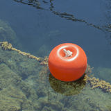 Mooring buoy floating on the sea Royalty Free Stock Photo