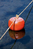 Mooring buoy floating on the sea Stock Photo