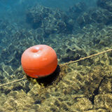 Mooring buoy floating on the sea Royalty Free Stock Images