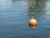 Mooring buoy floating on the sea Royalty Free Stock Photography