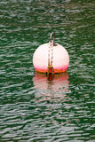 Mooring buoy on water Royalty Free Stock Image