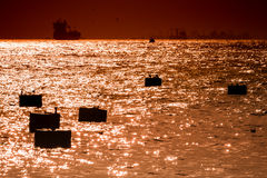 Mooring Buoys and Ships Silhouette at Sunset in Bosphorus, Istan Royalty Free Stock Images