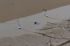 Mooring chains, ropes and buoys, beach at low tide. Royalty Free Stock Photo