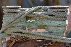 Mooring at the dock. Ropes connected to mooring at the dock Stock Image