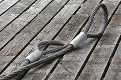 Mooring equipment on wooden pier Stock Photos
