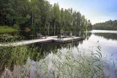 The mooring on the forest lake. Finland Stock Photography
