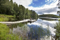 The mooring on the forest lake. Finland Royalty Free Stock Photos