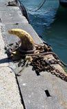 Mooring hook on a harbor wall Stock Photo